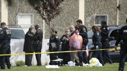 Police officers clear the scene after at least six people were killed and a number injured in multiple shootings at a private religious college April 2, 2012 in Oakland, California (AFP Photo / Kimihiro Hoshino)