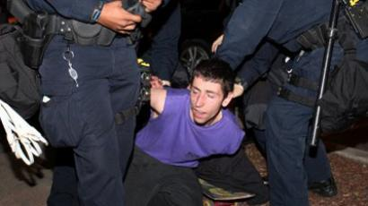 Oakland police detain an Occupy Oakland protester in downtown Oakland during the May Day protest on May 1, 2012 (AFP Photo / Kimihiro Hoshino)
