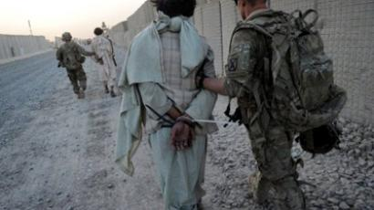 US soldiers from Bravo and Delta Company, 2-87 Infantry Battalion, 3rd Brigade Combat Team escort suspected Taliban insurgents to the Forward Operating Base Pasab in Zahri district of Kandahar province on August 15, 2011, following their capture during a five hour ground and air assault operation (AFP Photo / Romeo Gacad)