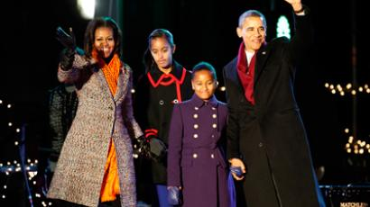 President Barack Obama and the first family arrive to take part in the National Christmas Tree Lighting ceremony in Washington December 1, 2011 (Reuters / Molly Riley)