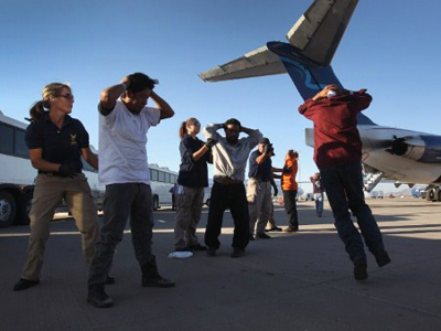 Undocumented Guatemalan immigrants are searched before boarding a deportation flight to Guatemala City, Guatemala at Phoenix-Mesa Gateway Airport on June 24, 2011 in Mesa, Arizona (John Moore / Getty Images / AFP)