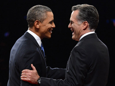 Republican presidential candidate Mitt Romney (R) and US President Barack Obama (L) greet one another at Magness Arena moments before the start of their first debate at the University of Denver in Denver, Colorado, October 3, 2012. (AFP Photo/Michael Reynolds)