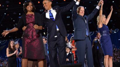 First Lady Michelle, US President Barack Obama, Vice-President Joe Biden and Second Lady Jill Biden acknowledge supporters following Obama's victory speech in Chicago on November 7, 2012 (AFP Photo / Jamel Samad)