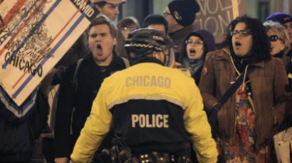 Police hold back demonstrators from Occupy Chicago and Stand Up Chicago as they protest outside the Chicago Board of Trade Building November 17, 2011 in Chicago, Illinois (Scott Olson / Getty Images / AFP)