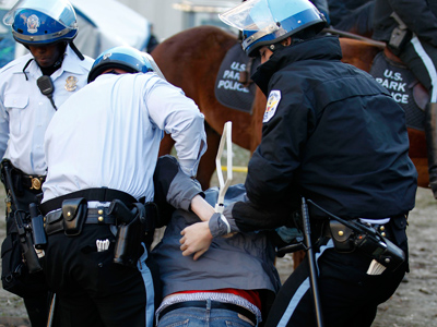Police arrest an Occupy DC protester after activists erected a large wooden structure in McPherson Square in Washington December 4, 2011 (Reuters / Jose Luis Magana)