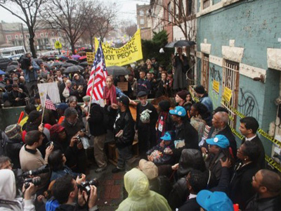 Community activists and over two hundred members of the Occupy Wall Street movement rally around a forclosed home during a march in the impoverished community of East New York to draw attention to foreclosed homes in the community. (Spencer Platt/Getty Images/AFP)