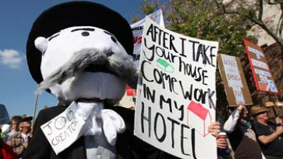 An Occupy LA protester dressed as the Monopoly game banker marches in the Move Your Money March on what is being called Bank Transfer Day (AFP Photo / David McNew)