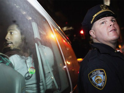 An Occupy Wall Street protester sits in a police van after being arrested during a demonstration to show support for their counterparts in Oakland, California. (Spencer Platt/Getty Images/AFP)