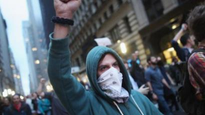 Demonstrators associated with the 'Occupy Wall Street' movement face off with police in the streets of the financial district after the deadline for their removal from Zuccotti park. (Spencer Platt/Getty Images/AFP)