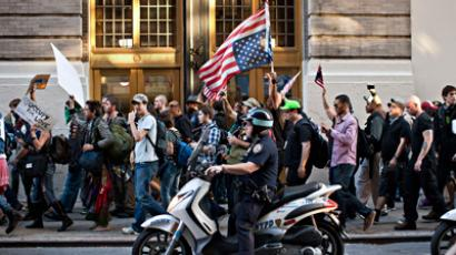 Members of Occupy Wall Street march from Washington Square Park to the Financial District, in New York, September 15, 2012 (Reuters)