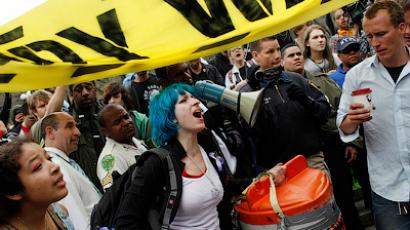 Occupy Wall Street protestors react as they are told to remove banners and signs from an area of Union Square Park in New York City by police March 21, 2012 (Reuters / Mike Segar)