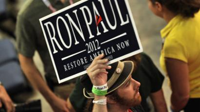 A supporter of Republican presidential candidate Ron Paul displays a Ron Paul poster after the Chairman of the Republican National Convention (RNC) Reince Priebus gaveled the convention to order at the Tampa Bay Times Forum in Tampa, Florida, on August 27, 2012. (AFP Photo/Stan Honda)