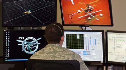 U.S. Air Force First Lieutenant Zachary Goff operates the control console to run a test flight of a drone at the Micro Air Vehicles lab at Wright Patterson Air Force Base in Dayton, Ohio, July 11, 2011 (Reuters / Skip Peterson)