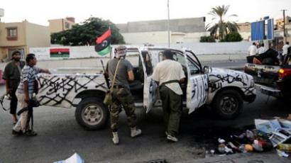 Libyan rebels get into a vehicle in the capital Tripoli (AFP Photo / Getty Images)