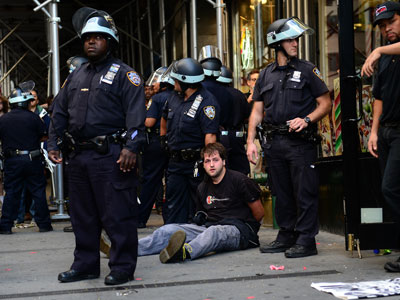 A participant in Occupy Wall Street protest is arrested by police during a rally to mark the one year anniversary of the movement in New York.(AFP Photo / Emmanuel Dunand)