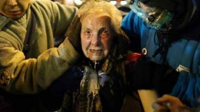 Seattle activist Dorli Rainey, 84, reacts after being hit with pepper spray during an Occupy Seattle protest on Tuesday, November 15, 2011 at Westlake Park. (Photo: Joshua Trujillo / Seattlepi.com)