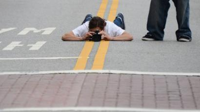 Photographers take pictures of a rally in downtown Los Angeles (AFP Photo /Joe Klamar)