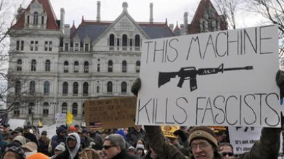 Jared Jeanotte of Long Island, New York, displays a sign during the Guns Across America pro-gun rally at the State Capitol in Albany, New York, January 19, 2013. (Reuters / Hans Pennink)