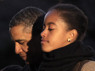 U.S. President Barack Obama and his daughter Malia. (Reuters / Kevin Lamarque)
