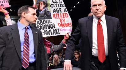 Anti-war protesters shout slogans as John Brennan (R), President Barack Obama's pick to lead the CIA, arrives to testify before a full committee hearing on his nomination to be director of the Central Intelligence Agency (CIA) in the Hart Senate Office Building in Washington, DC, on February 7, 2013 (AFP Photo / Jewel Samad)