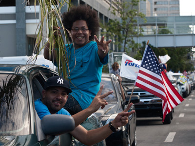 Supporters of the pro-statehood New Progressive Party wave flags after casting their vote to elect the local government and participate in their fourth political status plebiscite and decide among statehood, independence or sovereign state with association with the U.S. in San Juan, November 6, 2012 (Reuters / Ana Martinez)