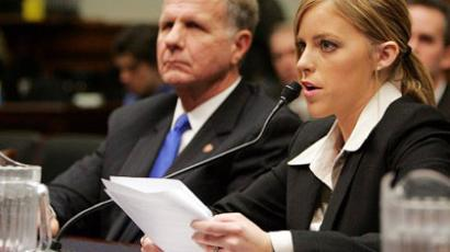 Washington : US Rep. Ted Poe (L) R-TX listens to testimony by Jamie Leigh Jones. (AFP Photo / Tim Sloan)