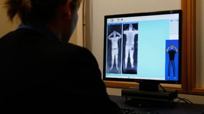 A security officer examines a computer screen showing a scan from a RapiScan full-body scanner, being trialled by Manchester Airport, during a photocall at the airport, in Manchester(Reuters / Phil Noble)