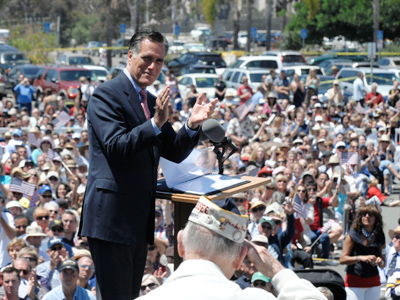 Mitt Romney (L), U.S. Republican presidential candidate and former Massachusetts governor, applauds a World War II veteran during a memorial day ceremony held at the Veterans Museum & Memorial Center in San Diego, California May 28, 2012 (Reuters/Denis Poroy)