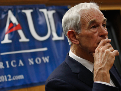 U.S. Republican presidential candidate and Congressman Ron Paul listens to questions at a Town Hall meeting at the Ericson Public Library during a campaign stop in Boone, Iowa December 8, 2011 (Reuters / Jim Young)