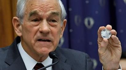 Washington: Republican presidential candidate U.S. Rep. Ron Paul (R-TX) (C) holds up a one-ounce silver coin while questioning Federal Reserve Bank Board Chairman Ben Bernanke during a full hearing of the House Financial Services Committee on Capitol Hill February 29, 2012. (Chip Somodevilla/Getty Images/AFP )