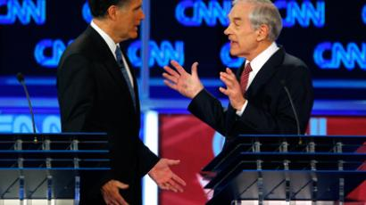 Republican presidential candidate former Massachusetts Governor Mitt Romney (L) and U.S Representative Ron Paul (R-TX) discuss a question during the Republican presidential candidates debate in Jacksonville, Florida January 26, 2012 (Reuters / Scott Audette)