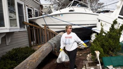 Regina Yahara-Splain cleans out her home after it was damaged by Superstorm Sandy on November 1, 2012 in Highlands, New Jersey.  (Andrew Burton/Getty Images/AFP)