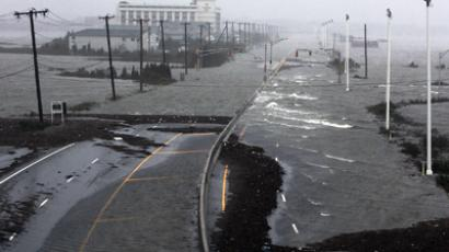 US Route 30, the White Horse Pike, one of three major approaches to Atlantic City, New Jersey, is covered with water from Absecon Bay in this view looking west, during the approach of Hurricane Sandy, October 29, 2012. (Reuters / Tom Mihalek)