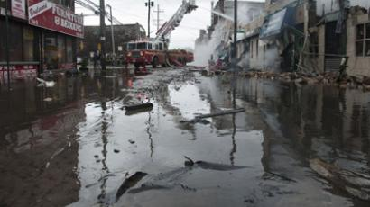 Firefighters work to extinguish a fire on a flooded street in New York, October 30, 2012. (Reuters/Keith Bedford)