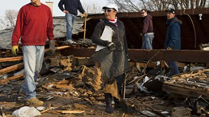 People pause while dismantling a home that was destroyed by hurricane Sandy, in Union Beach, New Jersey. (Reuters / Andrew Burton)