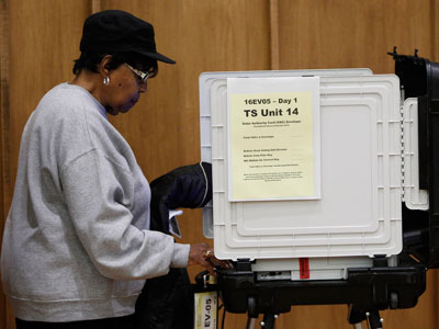 A woman votes early at a polling station in Silver Spring, Maryland October 27, 2012. Early voters could account for up to 40 percent of all ballots cast in the 2012 U.S. presidential election, and polls of people who already voted show President Barack Obama with a comfortable lead over Republican challenger Mitt Romney.(Reuters / Gary Cameron)