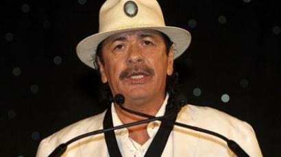 US, Atlanta:Singer and Beacon Award winner Carlos Santana speaks at the MLB Beacon Awards Banquet at the Omni Hotel on May 14, 2011 in Atlanta, Georgia. Mike Zarrilli/Getty Images/AFP