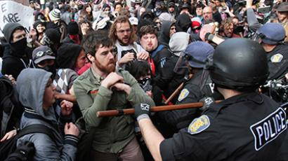 Occupy Seattle protesters are pushed back by police officers during a march and demonstration on May Day in downtown Seattle, Washington May 1, 2012 (Reuters/Robert Sorbo)