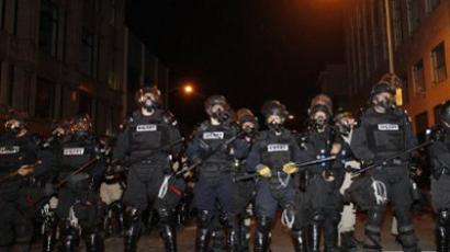 Police officers form a line to disperse the Occupy Oakland protesters  (AFP Photo / Kimihiro Hoshino)