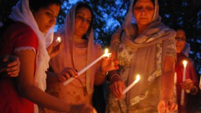 Members of Wisconsin's Sikh community conduct a candle-light vigil for six people killed in an attack the day before on a Wisconsin Sikh temple on August 6, 2012 in Brookfield, Wisconsin (AFP Photo / Mira Oberman)