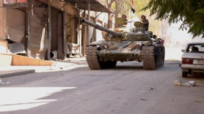 Soldiers loyal to President Bashar al-Assad travel in a Syrian Army tank in al-Arqoub neighbourhood, after clashes between Free Syrian Army fighters and regime forces in Aleppo city September 23, 2012. (Reuters/George Ourfalian)