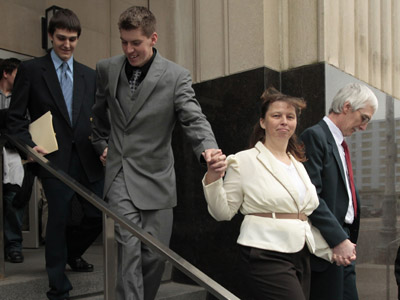 David Stone Sr. (R) holds the hand of his wife Tina while they leave the federal courthouse with their sons David Jr. (2nd L), and Joshua in Detroit, Michigan March 29, 2012. David Brian Stone Sr., the leader of the group called the Hutaree, and his son Joshua Stone each pleaded guilty before Judge Victoria Roberts in federal court in Detroit to possession of a machine gun. (Reuters / Jeff Kowalsky)