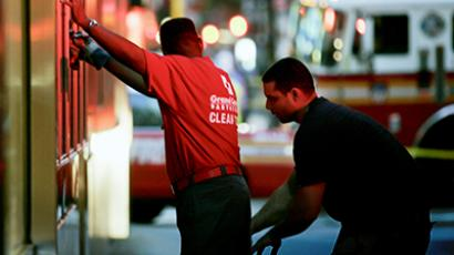 An unidentified man is stopped by police officers in New York. (Reuters / Shannon Stapleton)