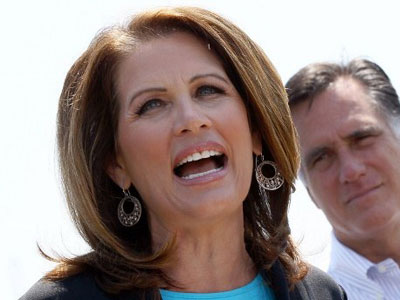 Republican presidential candidate and former Massachusetts Gov. Mitt Romney (R) listens as U.S. Rep. Michele Bachmann (R-MN) (L) speaks during a campaign event at Crofton Industries May 3, 2012 in Portsmouth, Virginia. Bachmann, a former candidate for the Republican nomination, officially endorsed Romney's campaign during the event. (Win McNamee/Getty Images/AFP)