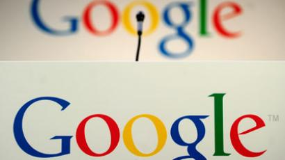 A microphone stands in front of a Google logo during a press annoucement at Google headquarters in New York, May 21, 2012. (AFP Photo/Emmanuel Dunand)