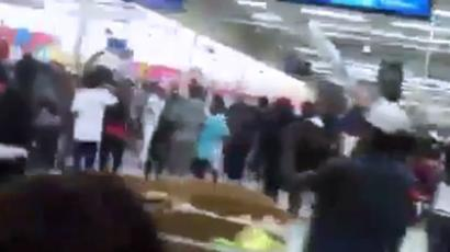 Hundreds of teenagers storm Wal-Mart in criminal flash mob (Still from YouTube video/isingjay94)