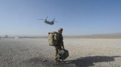 A US soldier walks as a Chinook helicopter prepares to land at Forward Operating Base (FOB) Sharano in Sharano district Paktika province. (AFP Photo/Ted Aljibe)
