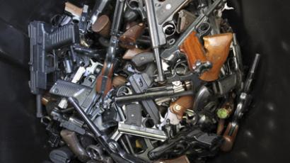 Hand guns that were turned in by their owners are seen in a trash bin at a gun buyback held by the Los Angeles Police Department following the mass shooting at Sandy Hook Elementary School in Connecticut, in Los Angeles, California, December 26, 2012. (Reuters/David McNew)