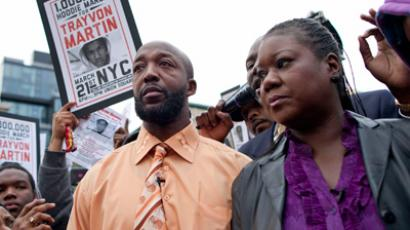 "Tracy Martin (L), father of slain Florida teen Trayvon Martin, and Sybrina Fulton, Trayvon Martin's mother, join a protest called ""A Million Hoodies March"" to demand justice for their son's death in New York's Union Square March 21, 2012 (Reuters / Andrew Burton)"