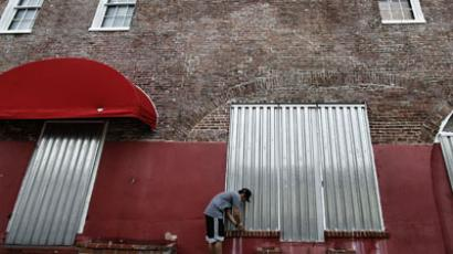 Arthur Asti installs storm shutters, Florida.(AFP Photo / Marc Serota)